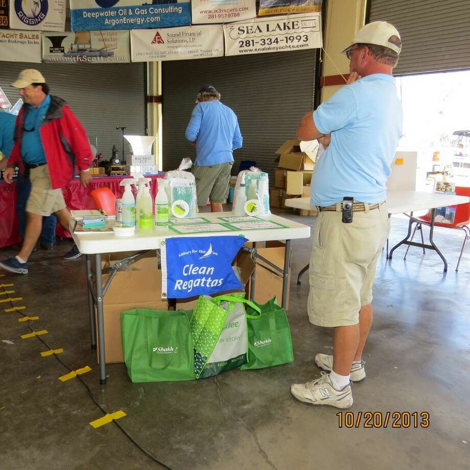 A Harvest Moon Regatta racer studies the Clean Regatta materials at their booth in the Port Aransas Pavilion after last year's regatta from Galveston across the Gulf of Mexico.