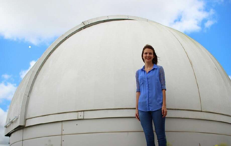 ACC student Chelsi Nelson, of Pearland, stands next to the college Observatory. Nelson will attend a workshop at NASA after she was named a Community College Aerospace Scholar.