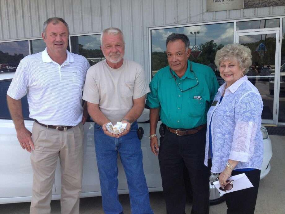 Pictured left to right are David Leonard of Liberty-Dayton Chrysler Jeep, Doug Long, Jesse Lopez of Liberty Coin and Collectibles, and Mary Anne Campbell of the Liberty-Dayton Area Chamber of Commerce. Photo: Submitted Photo
