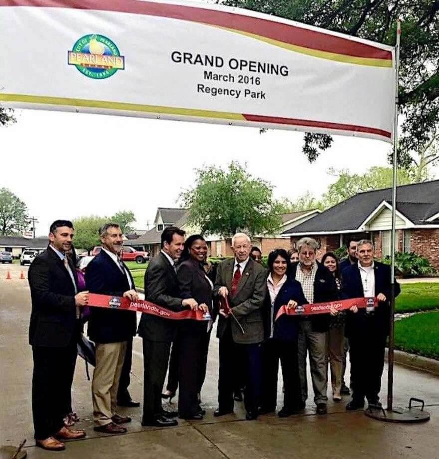 City officials and Mayor Tom Reid cut the ribbon to mark the completion of the Regency Park project three months ahead of schedule.