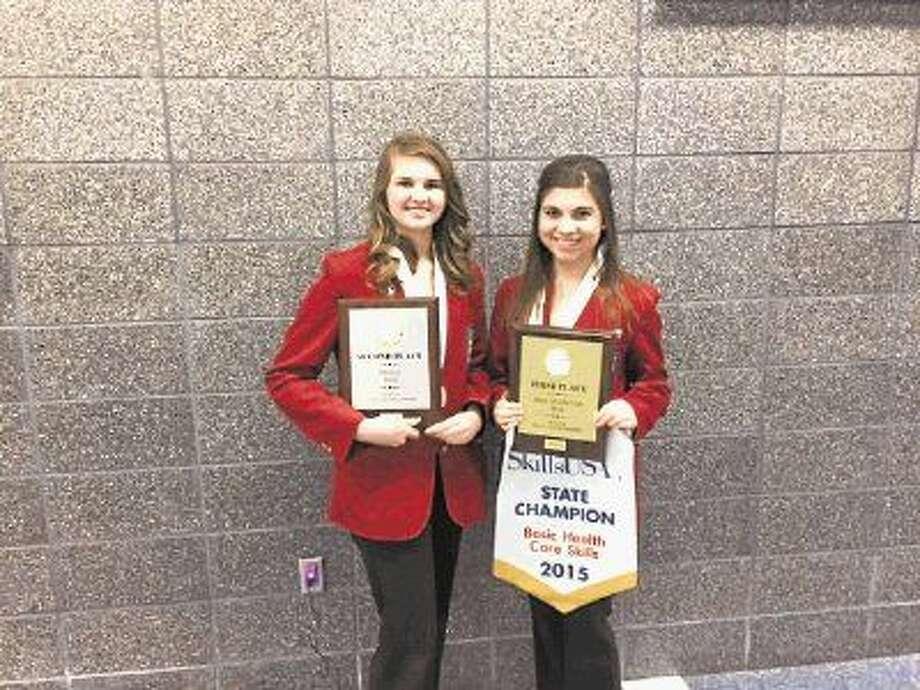 Jillian Abendroth, left, and Emily Navarro holding their State Championship awards. Photo: MISD