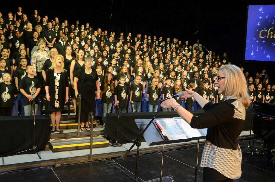 Sharon Paul, choral director at Cypress Creek High School, directs students and staff at the 2015 Cypress-Fairbanks ISD Elementary Choral Festival.