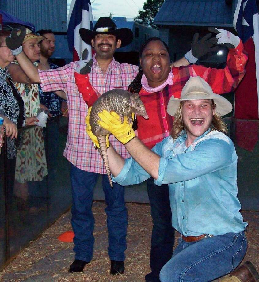 Eddie and Luaren celebrate their win with Swifty and Speedbump from Sparky Sparks' Armadillo Races at the 2015 Stars at Night Wild West Shindig.