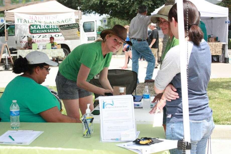 Volunteer, Candice Koern, signs in volunteers and vendors. Photo: Minza Khan