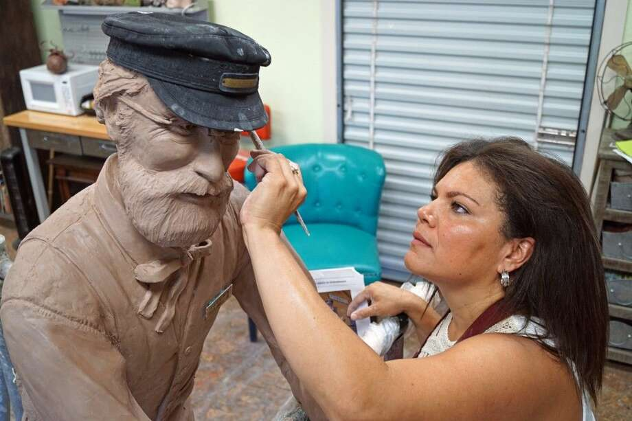 Artist Shirley Scarpetta works on a clay sculpture that is the basis for a finished bronze piece. Photo: Submitted
