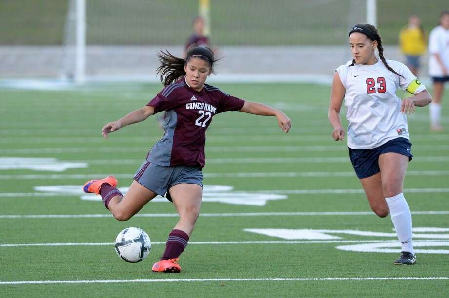 Cinco Ranch's Makayla Wang works against Lamar's Whitney Clark during their Bi-District Playoff game March 24 at Delmar Stadium in Houston. Find this and additional photos at HCNPics.com. Photo: Craig Moseley
