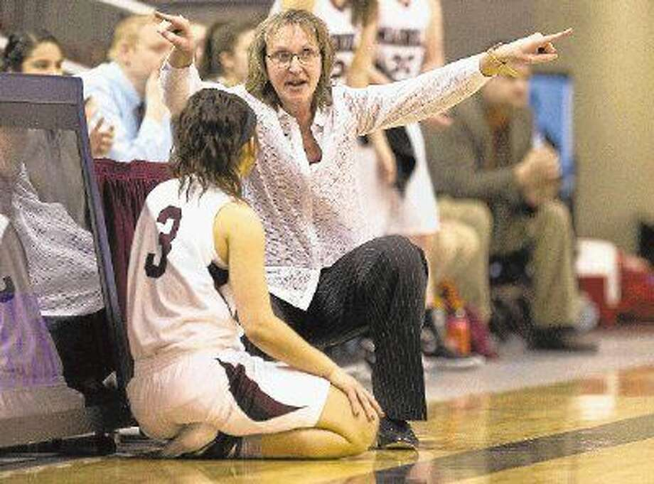 Magnolia coach Erika Ritter instructs guard Taylor Bearden during the second quarter of a Region III-5A semifinal girls basketball game against Crosby at the M.O. Campbell Center Friday. Photo: Jason Fochtman