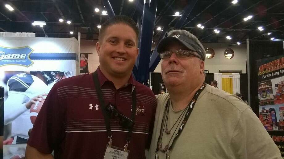 Magnolia West coach Shawn Bell, with Courier sports editor Jim Mashek at the THSCA convention in Houston. Bell, the former Baylor quarterback, guided the Mustangs to a memorable upset over Summer Creek in the 2013 area-round playoffs.