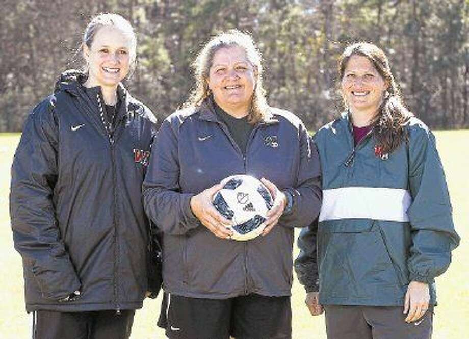 The Woodlands girls soccer coaches (from left to right) Karen Lucas, Dina Graves, and Paige Jeanes pose for a portrait. Photo: Jason Fochtman