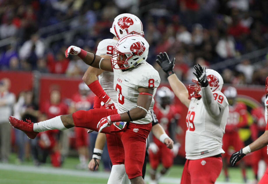 Katy's Jo Vanni Stewart and Travis Whillock celebrate a sack of Manvel's Deriq King during the Class 6A Division II Region 3 playoff Dec. 5 at NRG Stadium in Houston. Photo: Staff Photo By Alan Warren
