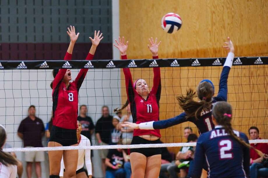 Fort Bend Austin's Madison Wetterstroem (8) and Paige Swinney (11) go high to block at the net during the Adidas Texas Volleyball invitational tournament Aug. 15. Visit HCNPics.com for more photos. Photo: Kirk Sides