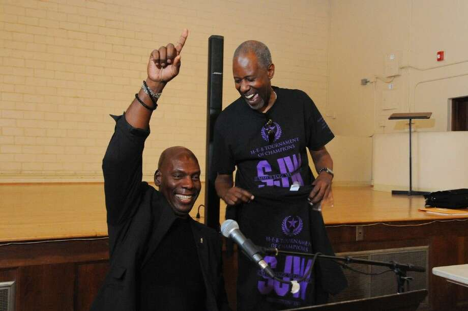 Ben Tankard holds up one one finger in celebration of receiving a group t-shirt , the HEB Tournament of Champions Summer Jazz Work Shop. The shirt was presented to him by one of the student jazz bands teachers Al Campbell. Photo: Tony Gaines