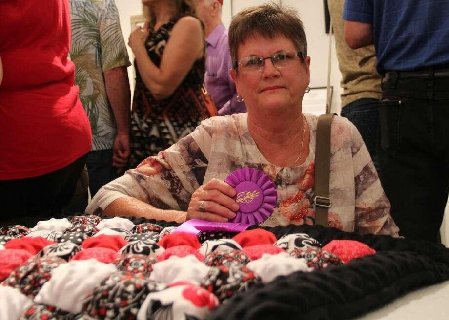 "Gloria Matlage won best in show at the COM Senior Adult Program Art Exhibit for her quilt, ""Adi's Blanket of Love."""
