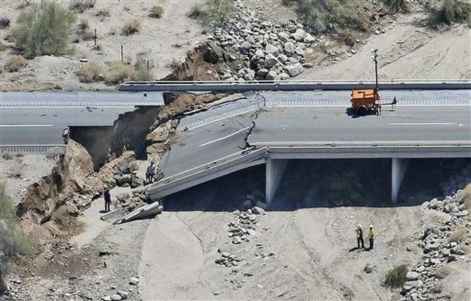 This aerial photo shows the collapsed elevated section of Interstate 10, Monday in Desert Center, Calif. All traffic along one of the major highways connecting California and Arizona was blocked indefinitely when the bridge over a desert wash collapsed during a major storm, and the roadway in the opposite direction sustained severe damage. Photo: Matt York