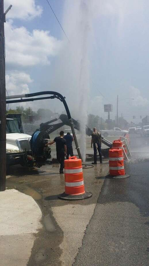 A 25-foot geyser blew from a water main Monday morning, Aug. 18, while Dayton city workers were repairing a small leak. Photo: ANDREW LANDRY