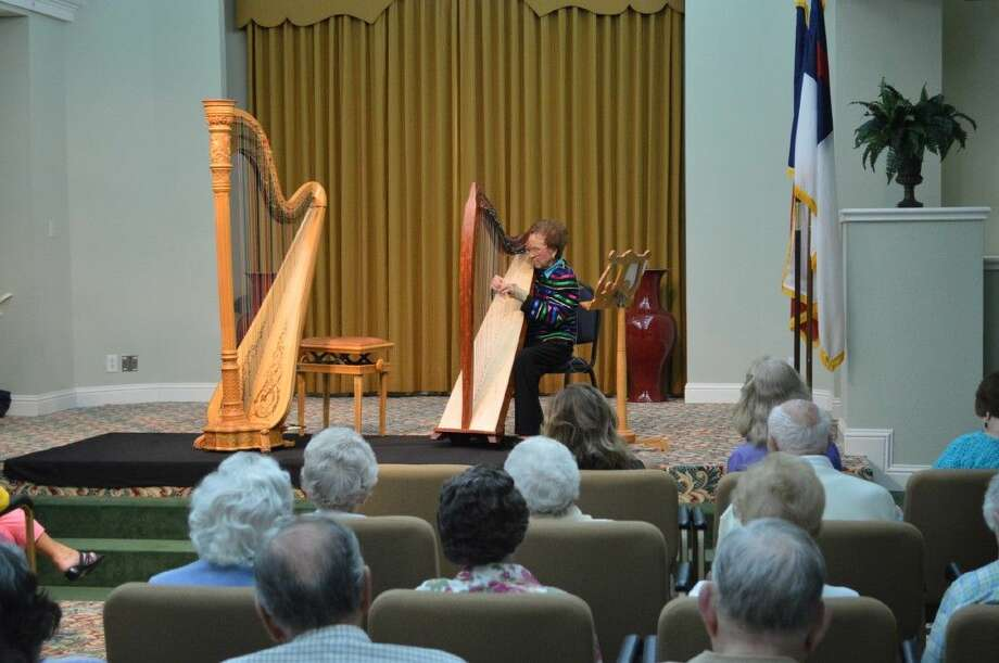 91-year-old Parkway Place resident Louise Trotter shares her love of music during a special harp concert for her fellow residents at the senior living community on Monday, July 20.