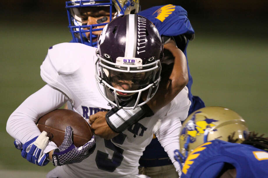 Ridge Point's Connor Talbott runs against Elkins' A. J. Mathews on Oct. 16 at Hall Stadium in Missouri City. To view or purchase this photo and others like it, go to HCNPics.com. Photo: Staff Photo By Alan Warren