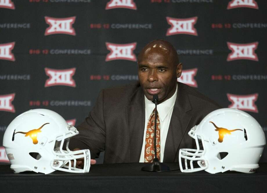 Texas head coach Charlie Strong speaks during the 2015 Big 12 Conference Football Media Days Tuesday in Dallas.