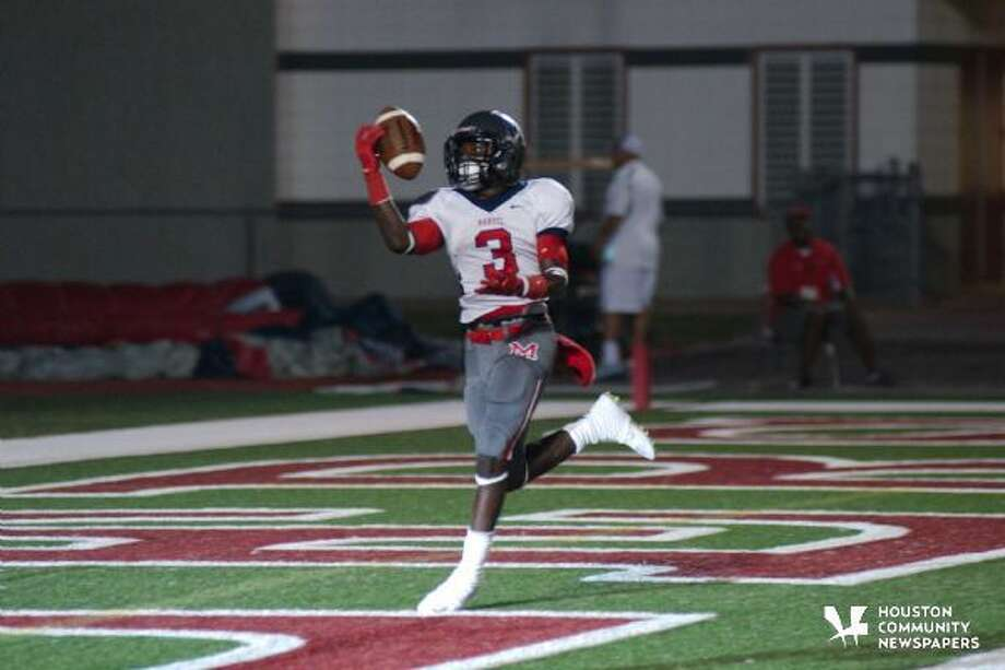Manvel's Qyalan Clay (3) makes a one-handed catch for a touchdown against Dawson Friday, Oct .10