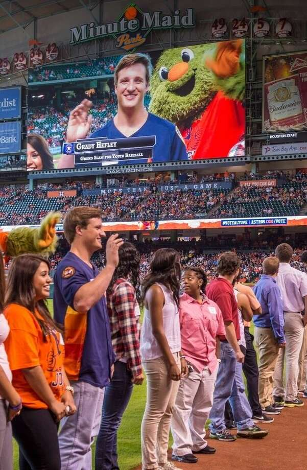 Grady Hefley, 19, far left, receives the Minute Maid Grand Slam for Youth Scholarship at Minute Maid Stadium on June 27.