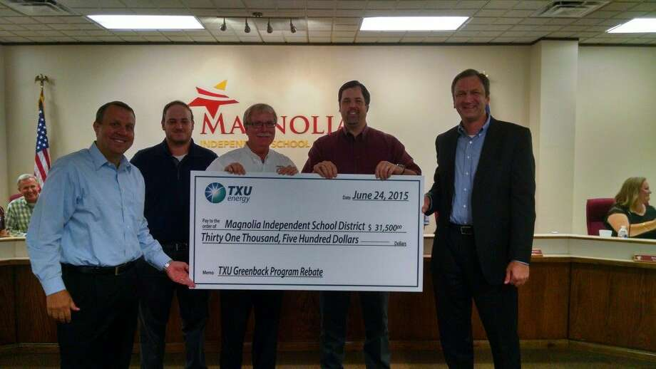 Pictured, from left to right, are TXU Energy Director of Large Business Markets Jason Schultz, MISD Risk and Purchasing Manager Garrett Matej, MISD Board President Steve Crews, MISD Chief Financial Officer Erich Morris, and TXU Senior Sales Executive of Major Accounts Larry Kalbac. Photo: MISD