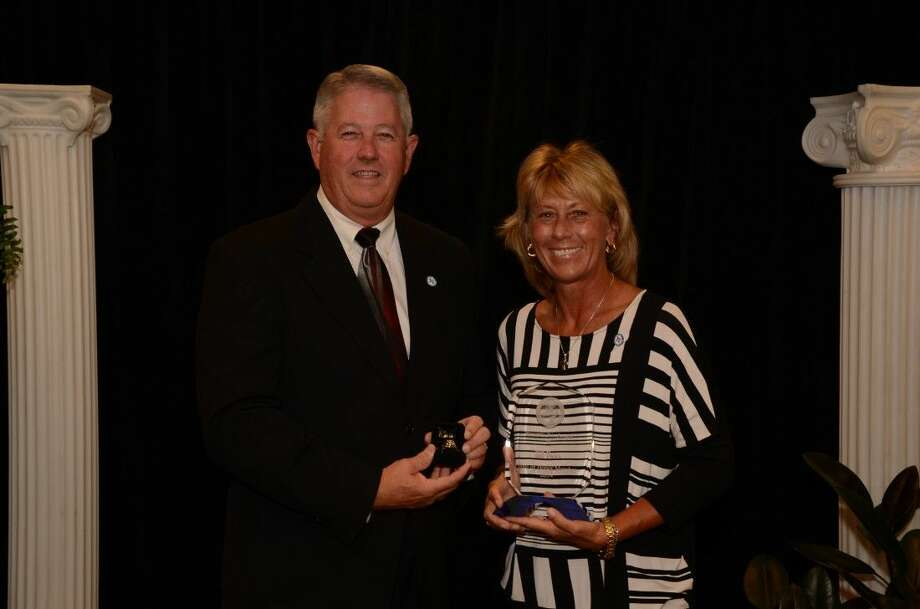CCISD Athletic Director Bill Daws and Assistant Director of Athletics Debbie Fuchs celebrate at the Texas High School Athletic Directors Association 2014 state conference and banquet. Photo: Courtesy Clear Creek ISD