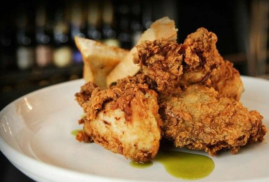"Max's Wine Dives fried chicken is marinated in a spicy and delicious jalapeño-buttermilk, breaded in a seasoned flour and deep fried ""low and slow,"" which is different from many other fried chicken recipes. Photo: Courtesy Photo"
