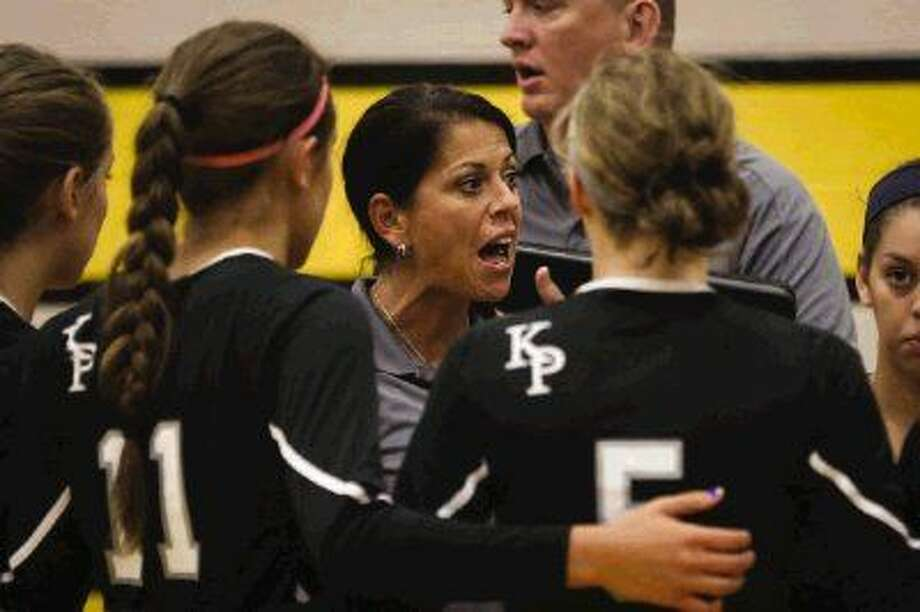 Kingwood Park head coach Tammy White speaks with her team during a high school volleyball game against Conroe in August 2014 at Conroe High School. Photo: Michael Minasi