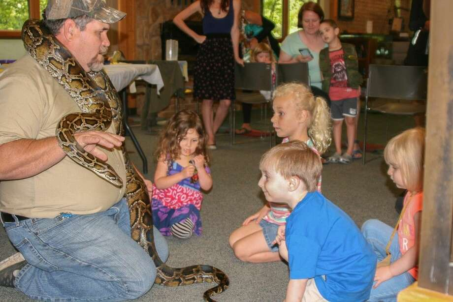 Lucky makes friends with Tadpoles Club attendees at Jones Park. Photo: Courtesy Photo