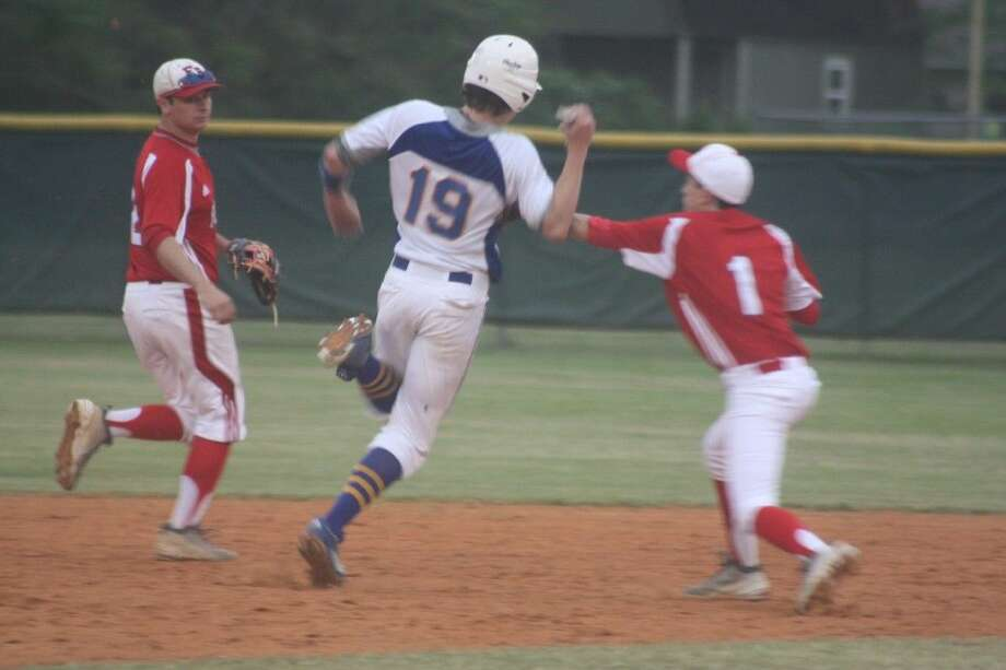 FBCA second baseman Jake Sweeney applies the tag on Brazosport Christian's Logan Pruismann in the third inning, ending a rundown. Looking on for the Warriors is Jake's older brother, Nace. Pruismann was going to be the losing pitcher until the 2014 state champs scored three runs on the 2015 state champs in their final at-bat. Photo: Robert Avery