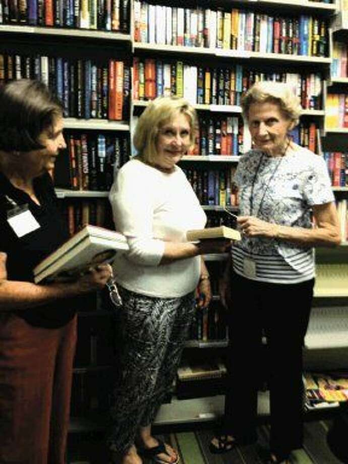 FOLK board president Carolyn Humphrey, left, and bookstore volunteers Karen Miller and Jan Nicholson enjoy working in the used bookstore at the Kingwood Branch Library, finding that it is a great way to make a positive and lasting impact on their community.