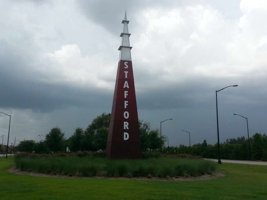 A marker on Highway 90A near Present Street, the proposed 90A commuter rail line would run, alerts visitors and residents that they've entered the city of Stafford. Photo: Zach Haverkamp