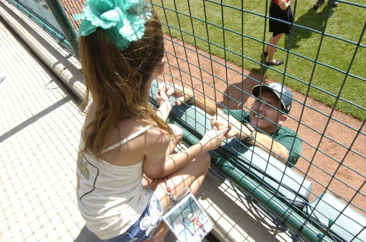 Sophia Smith, 8 talks to her father Texas Manager Don Smith through the fence before their game against Washington in the Little League World Series in South Williamsport, PA on August 18, 2014.