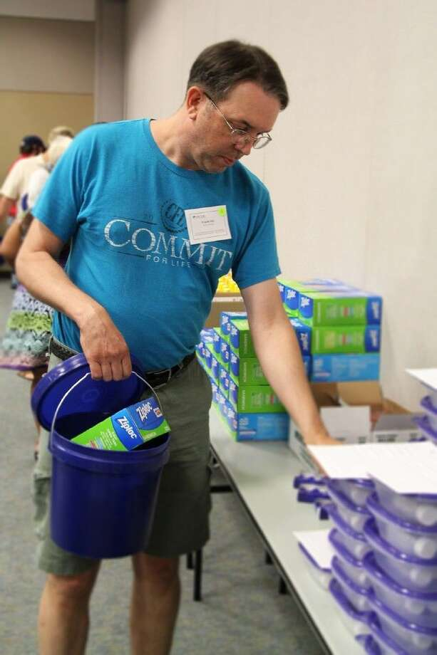 "Cypress Springs High School physics teacher Frank Gill goes through a product bucket assembly line to take products back to the classroom as a ""show-and-tell"" for students during the Science Teachers and Industry Workshop at the Harris County Department of Education. (Photo courtesy HCDE/Amanda Arnold) Photo: Amanda Arnold"