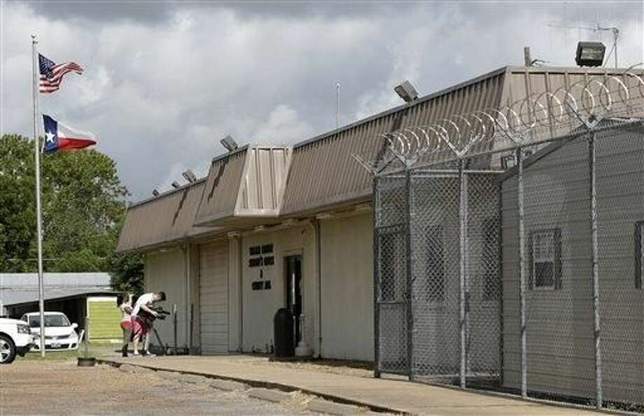 A videographer shoots outside the Waller County Jail Wednesday in Hempstead where Sandra Bland died in a cell. Photo: Pat Sullivan