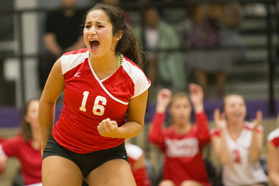 Splendora's Cailin Buchanan celebrates after one of the final points in the match is scored during Splendora's victory over Humble on Aug. 19, 2014, at Humble High School. Photo: Andrew Buckley