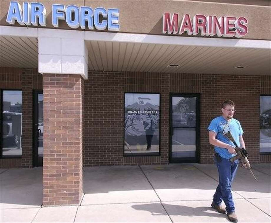Joshua B. Van Natter stands outside a military recruiting center on Tuesday in Logan, Utah. Photo: Eli Lucero