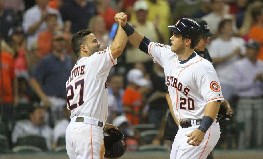 Houston Astros' Preston Tucker is greeted at the plate by Jose Altuve, left, after his two-run home run against the Boston Red Sox during the fifth inning of a baseball game Wednesday in Houston.