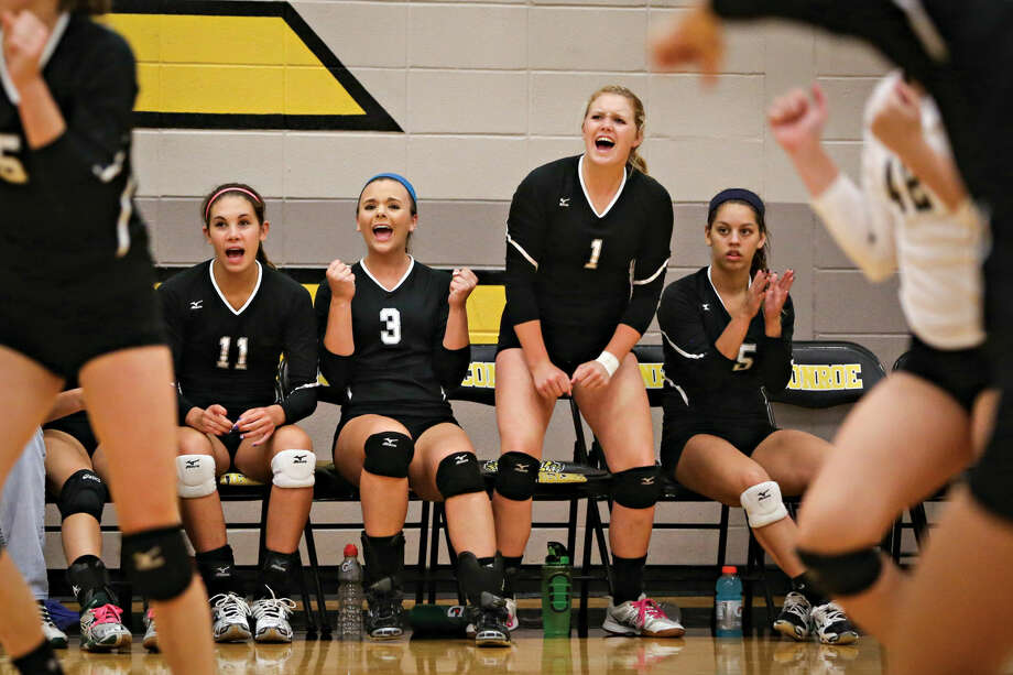 Kingwood Park players celebrate during the high school volleyball game against Conroe on Tuesday, Aug. 19, 2014 at Conroe High School. Photo: Michael Minasi