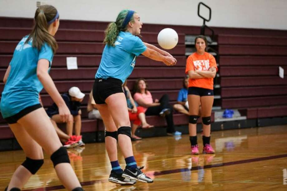 Magnolia's Ginger Reader goes for a dig during the Magnolia Summer Volleyball League on Tuesday, July 15, 2014, at Magnolia High School.