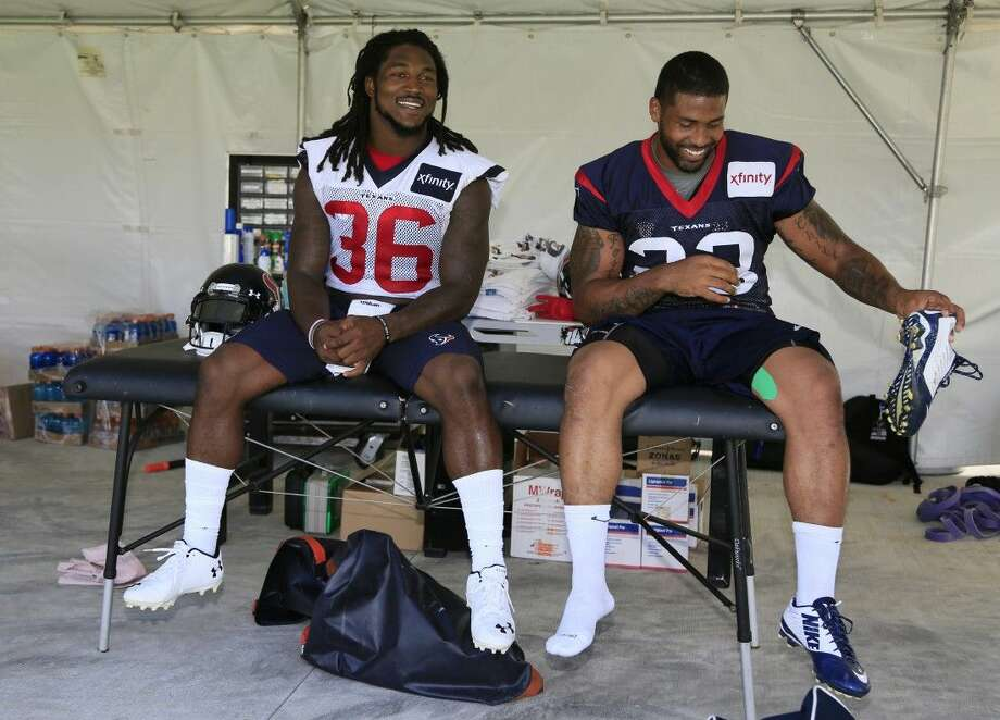 Houston Texans safety D.J. Swearinger (36) and Arian Foster after a joint practice with the Denver Broncos on Tuesday in Englewood, Colo.