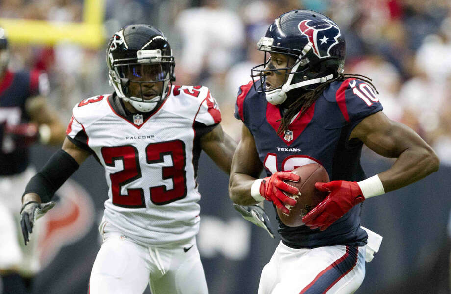 Houston Texans wide receiver DeAndre Hopkins (10) catches a pass as Atlanta Falcons cornerback Robert Alford (23) defends in the first quarter of an NFL preseason game at NRG Stadium Saturday. Go to HCNpics.com to view more photos from the game. Photo: Jason Fochtman