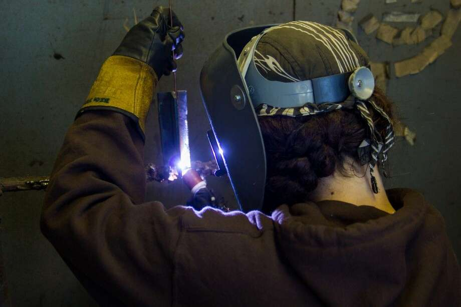 College of the Mainland student Daviana Tucker completes a weld in a class.