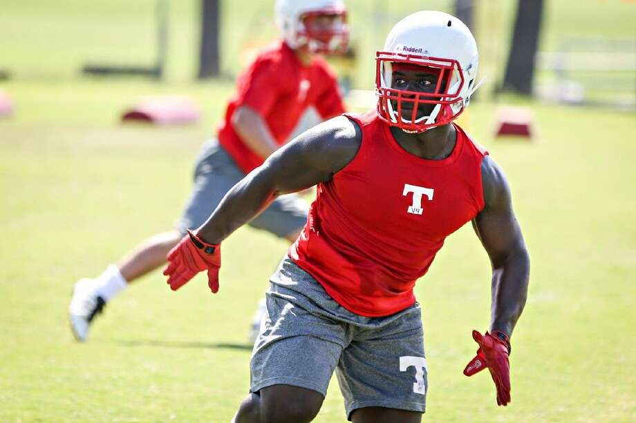 Tomball's Percy Alford runs a drill during practice on Tuesday, Aug. 12, 2014, at Tomball High School. Photo: Michael Minasi