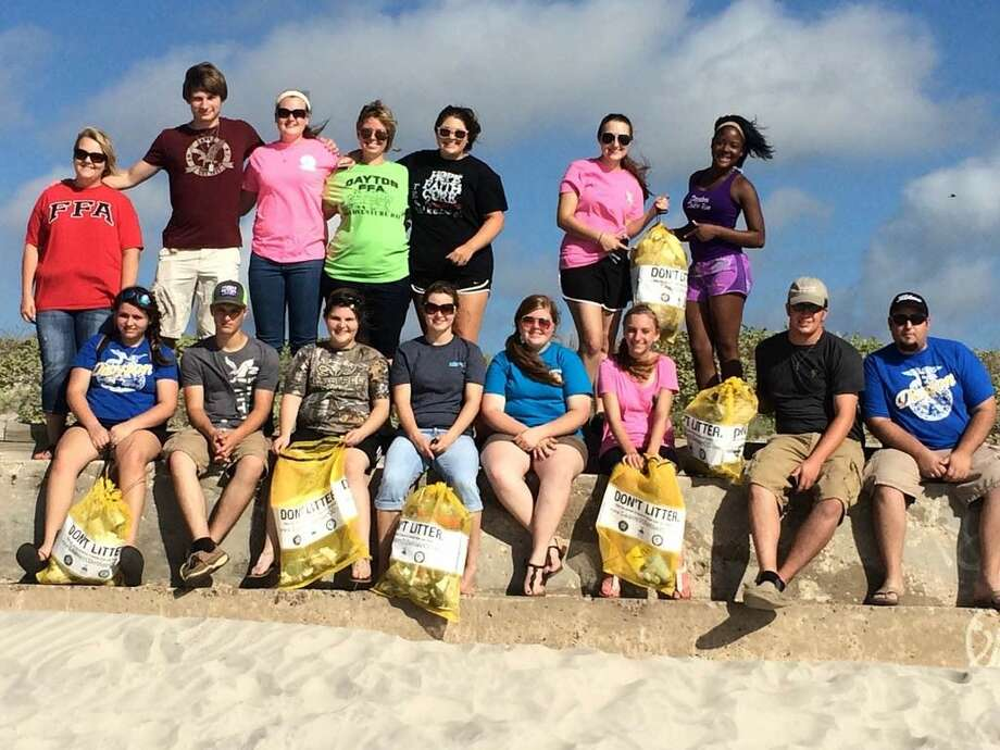 Dayton FFA members attended the Texas FFA State Convention in Corpus Christi July 13-17 and while there participated in a day of service to help clean up a stretch of beach. Photo: Submitted Image