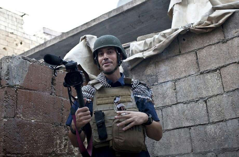 In this November 2012, file photo, posted on the website freejamesfoley.org, shows American journalist James Foley while covering the civil war in Aleppo, Syria. In a horrifying act of revenge for U.S. airstrikes in northern Iraq, militants with the Islamic State extremist group have beheaded Foley — and are threatening to kill another hostage, U.S. officials say. Photo: NICOLE TUNG