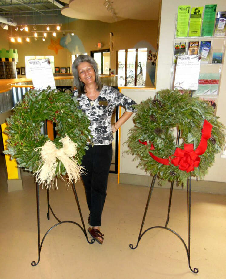 "Angela Colton, executive director of The Woodlands Children's Museum, invites one and all to celebrate ""Christmas in August"" at the 13th Annual Fall Home & Garden Show The Woodlands where the museum will kick off its annual fundraiser with presales of its fresh holiday centerpieces and wreaths."