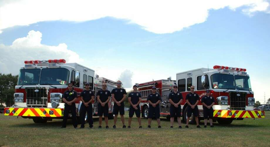 Galveston Fire Department Firefighters from Station One and Five stand in front of the two new 2014 Crimson Fire Pumper Trucks, ready for service.