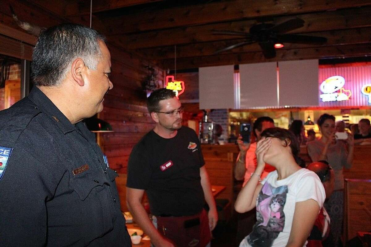 Sgt. Roy Castillo helps sing 'Happy Birthday' to a Texas Roadhouse patron.