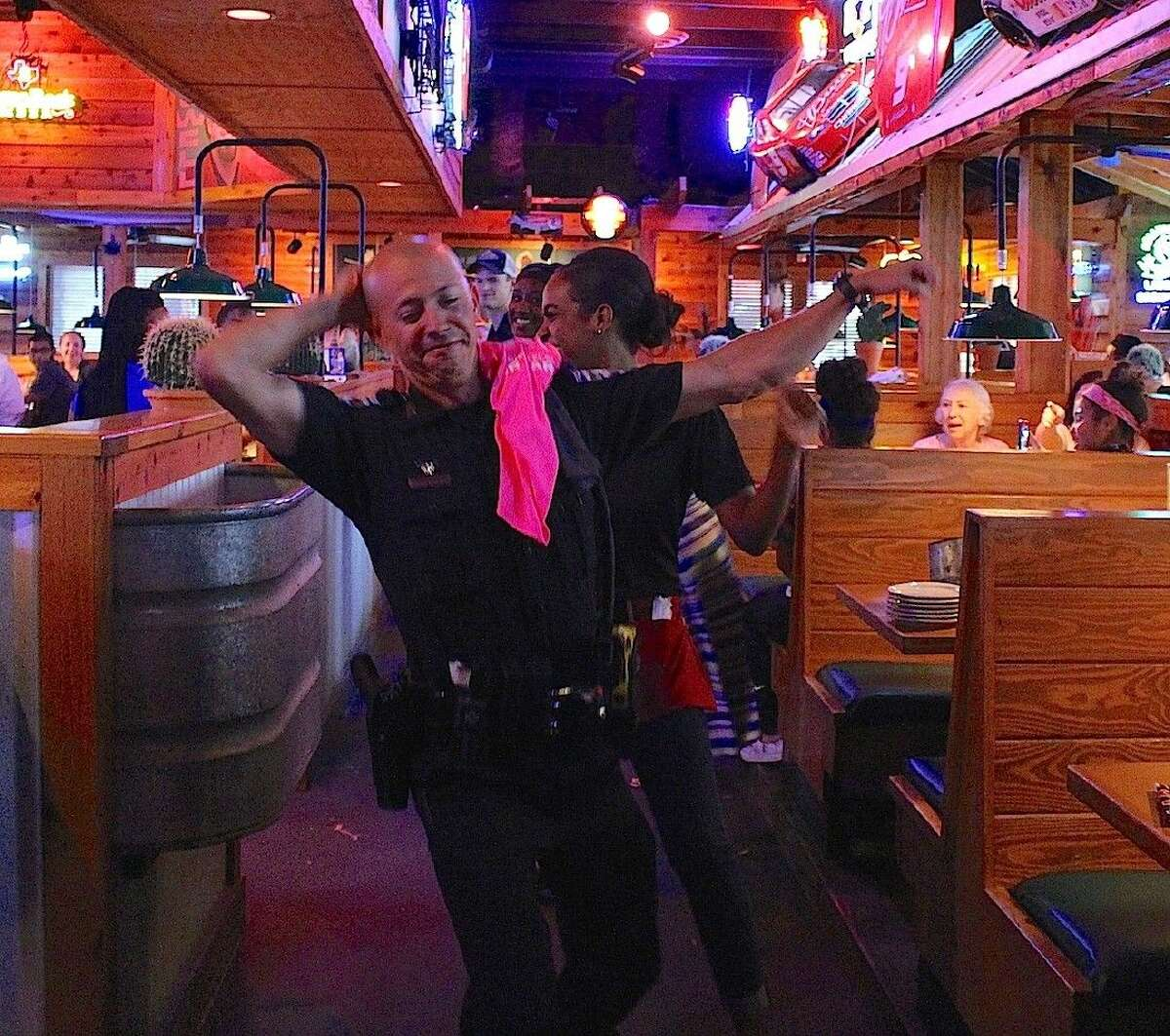 Officer Nick Palomo shows the wait staff how to do 'The Sprinkler.'